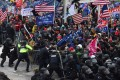 Supporters of outgoing President Donald Trump clash with police and security forces as they storm the barricades on their way to the US Capitol in Washington on January 6. Photo: AFP