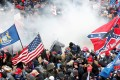 Tear gas is released into a crowd of protesters during clashes with Capitol police. Photo: Reuters