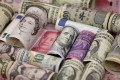 Comments by State Administration of Foreign Exchange (SAFE), which manages the bulk of China's forex assets, likely reflect Beijing's rising concerns about international uncertainties, according to analysts. Photo: Reuters