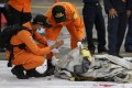 Members of the Indonesian rescue service inspect suspected parts of the missing Sriwijaya Air jetliner found in the water off Jakarta, on January 10. Photo: EPA-EFE