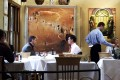 Italian restaurant Lucio's in Sydney will auction off the art collection adorning its walls which is almost as famous as the food. Photo: Getty Images