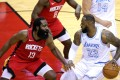 LeBron James, of the Los Angeles Lakers, battles with James Harden, of the Houston Rockets, in an NBA game. Photo: AFP