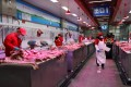 Pork on sale at the Xinfadi wholesale market in Beijing in November 2020. Photo: Reuters
