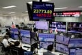 The Nikkei stock index on display at a foreign exchange trading company in Tokyo on November 4, 2020. Photo: Reuters