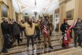 Supporters of President Donald Trump confront police officers inside the US Capitol on January 6. Photo: AP