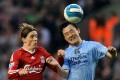 Manchester City's Sun Jihai beats Liverpool's Fernando Torres to the ball in an English Premier League game in 2008. Photo: AFP