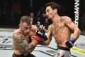 Max Holloway punches Alexander Volkanovski in their UFC featherweight title rematch at UFC 251. Photo: Jeff Bottari/Zuffa LLC via USA TODAY Sports