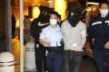 Two alleged triad members are led away by police after their arrest in the early hours of Thursday in Kowloon. Photo: Handout