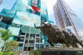 A bull sculpture stands in front of the Shenzhen Stock Exchange building. Chinese stocks have had a good start to the year, with the CSI 300 index surpassing its 2015 peak on January 5. Photo: Shutterstock