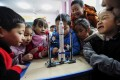 Children look at a model of the Long March rocket during an aerospace education lesson at a primary school in Yunyang county in southwestern China's Chongqing province on December 16, 2020. Photo: Agence France-Presse