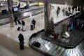 Travellers claim their baggage at Detroit Metropolitan Wayne County Airport in Michigan, US. Photo: Reuters