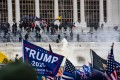 Supporters of US President Donald Trump clash with the US Capitol police during a riot at the US Capitol on January 6, in Washington. Photo: TNS