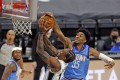 Christian Wood of the Houston Rockets blocks a shot from DeMar DeRozan of the San Antonio Spurs. Photo: AFP