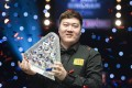 China's Yan Bingtao with the Paul Hunter Trophy after winning the Masters snooker final against Scotland's John Higgins in Milton Keynes, England. Photo: Xinhua