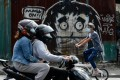 A mural reminds people to wear masks in Caloocan City, Metro Manila, Philippines. Photo: Reuters