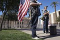 Members of the far-right Boogaloo Boys group stand in front of the Arizona State Capitol building in Phoenix on Sunday. Photo: AFP