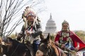 Shane Red Hawk of the Sicangu Lakota band of the Rosebud Sioux and his daughter Tshina Red Hawk prepare to begin a horseback ride Washington in April 2014 in protest against the Keystone XL pipeline. Photo: EPA
