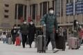 Passengers at Beijing's main railway station on Tuesday. Photo: AP