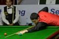 China's Yan Bingtao playing in the 2014 IBSF World Amateur Championship final against Pakistan's Mohammad Sajjad. Photo: AFP