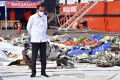 Indonesian President Joko Widodo stands next to the debris of the Sriwijaya Air flight SJ182 recovered from the waters off Jakarta, during a visit to the scene on January 20. Photo: EPA-EFE