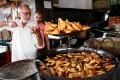 """Frying mutton samosa in Bangalore. Samosas are called the """"king of snacks"""" in India, but they originated in Egypt. Photo: Getty Images"""