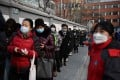 People line up to be tested for the coronavirus in Beijing on Friday. Photo: AFP