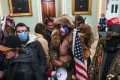 Trump supporters including Jacob Anthony Chansley (centre), a QAnon supporter, enter the Capitol in Washington on January 6. Photo: AFP