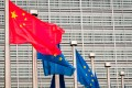 China's national flag flies beside European Union (EU) flags in Brussels in April 2019. Photo: Bloomberg