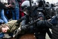 Protesters clash with riot police during a rally in support of jailed opposition leader Alexei Navalny in downtown Moscow, Russia on Saturday. Photo: AFP