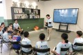 Adam Lai Ka-chi, general manager of Swallow Education, teaching a group of schoolchildren about responding to natural disasters. Photo: SCMP Handout