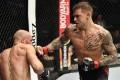 Dustin Poirier punches Conor McGregor in their lightweight main event at UFC 257. Photo: Jeff Bottari/Zuffa LLC