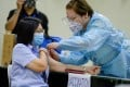 A health worker conducts a mock Covid-19 vaccination during a simulation exercise in Manila. Photo: Reuters