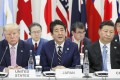 Then US president Donald Trump (left) sits with Japan's then prime minister Shinzo Abe and China's President Xi Jinping at the G20 Summit in Osaka, Japan, on June 28, 2019. A vision of trilateral cooperation that includes the US, China and Japan would prevent Asia from becoming a theatre of US-China competition. Photo: Kyodo