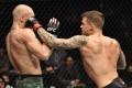 Dustin Poirier punches Conor McGregor in their lightweight fight during UFC 257. Photos: Jeff Bottari/Zuffa LLC