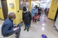 A screener registers residents at a Covid-19 vaccination site in the Brooklyn borough of New York. Photo: AP
