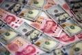 Chinese investors held approximately US$2.1 trillion, with about US$700 billion in equity and US$1.4 trillion in debt issued by US entities, according to the report by Rhodium Group and National Committee on US-China Relations. Photo: AFP