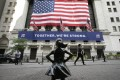 In this July 9, 2020 file photo, the Fearless Girl statue stands in front of the New York Stock Exchange in New York. Wall Street bankers in Asia are enjoying more bonuses that come with a revival in deal flows in the region. Photo: AP