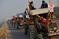 Farmers take part in a tractor rally in New Delhi to protest against new farm laws. Photo: Reuters