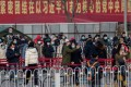 People line up in Beijing to be tested for the coronavirus on Saturday. City officials rushed to eradicate a new local cluster of cases believed to be linked to a more contagious virus variant. Photo: AFP