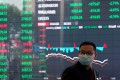 A man wearing a mask is seen inside the Shanghai Stock Exchange building at the Pudong financial district on February 28, 2020. Photo: Reuters