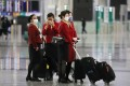 Aircrew members arrive at Hong Kong International Airport on December 22, 2020 after a ban on all passenger flights from Britain in a bid to stop a new strain of Covid-19 from reaching the city. Photo: Nora Tam