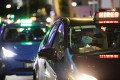 Taxis are seen at a traffic light in Singapore. A foreigner has been jailed for assaulting a taxi driver who took a wrong turn when driving him home. Photo: EPA-EFE