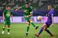 Renato Augusto (centre) of Beijing Guoan shoots in a game against Tianjin Teda in the 2020 Chinese Super League. Photo: Xinhua