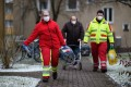 Rescue service employees in Goettingen, Germany, evacuate an elderly resident and his two cats before bomb disposal experts find and defuse four suspected World War II bombs from the city centre. Photo: DPA