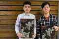 "Researchers from Liber Research Community Neon Yiu Ching-hei (left) and Chan Kim-ching present their study on ""nano flats"" built by Hong Kong developers. Photo: SCMP/ Joyce Ng"