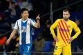 Espanyol's Wu Lei celebrates scoring his side's second goal as Barcelona's Jordi Alba looks dejected. Photo: Reuters