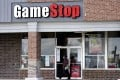 A woman walks past a GameStop store in Des Plaines, Illinois, on October 15, 2020. The money-losing video game retailer has been the focus of a trading war. Photo: AP