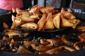 Hot and fresh samosas at a market in Bangalore. Photo: Getty Images