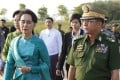Aung San Suu Kyi and Myanmar's Senior General Min Aung Hlaing. Photo: EPA
