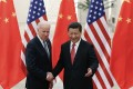 Chinese President Xi Jinping, right, shakes hands with then US vice-president Joe Biden in 2013 in Beijing. Photo: AP